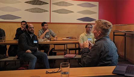 Meet up attendees discuss machine learning
